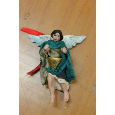 Angelo in terracotta con vestiti di stoffa 7 cm