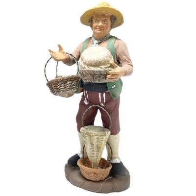 Uomo che vende cestini in terracotta 15 cm