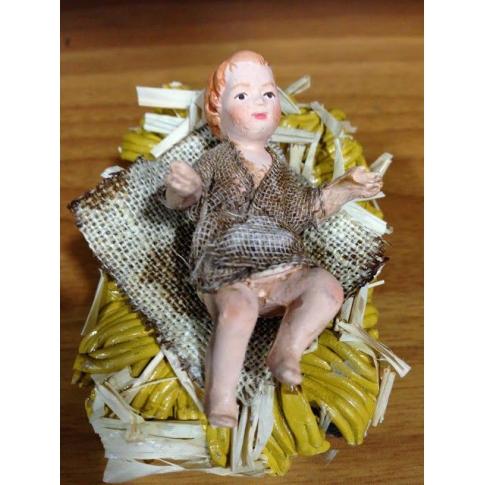Bambino Gesù in terracotta con vestiti di stoffa 12 cm