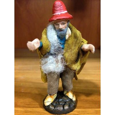 Uomo in terracotta con vestiti di stoffa 7 cm