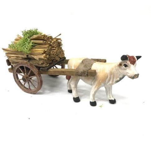 Mucca con carretto che trasporta fascine 10 cm