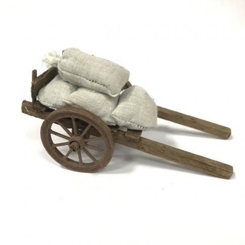 Carretto con sacchi di farina per pastori da 10 cm