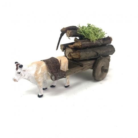 Mucca con carretto che trasporta legna 4 cm