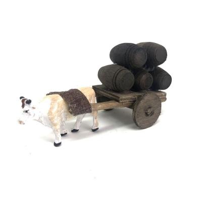 Mucca con carretto che trasporta botti 4 cm