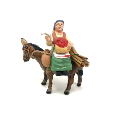 Donna che vende frutta seduta su asino in terracotta 7 cm