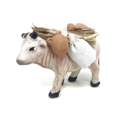 Mucca che trasporta sacchi anfore e fascine 7 cm