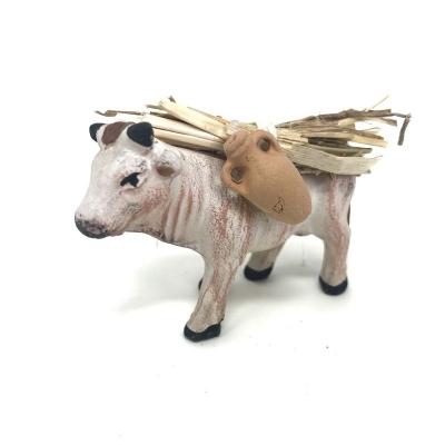 Mucca che trasporta anfore e fascine 7 cm