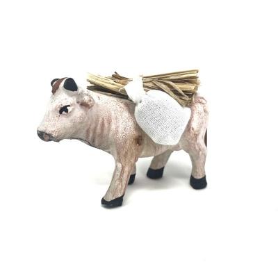 Mucca che trasporta sacchi e fascine 7 cm