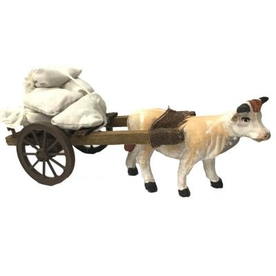 Mucca che trasporta sacchi 10 cm presepe