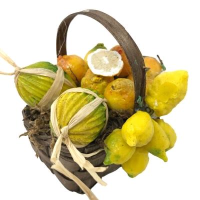 Cestino con limoni e melone in cera