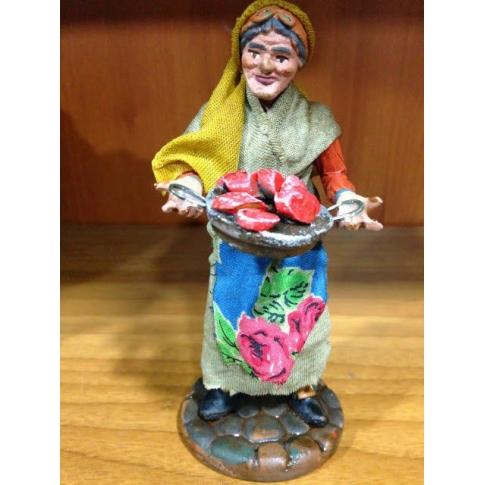Donna con piatto di carne in terracotta con vestiti di stoffa 12 cm