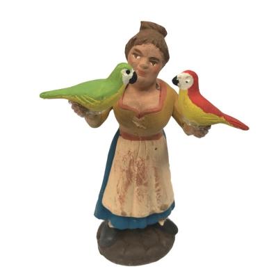 Donna con pappagallo in terracotta 10 cm