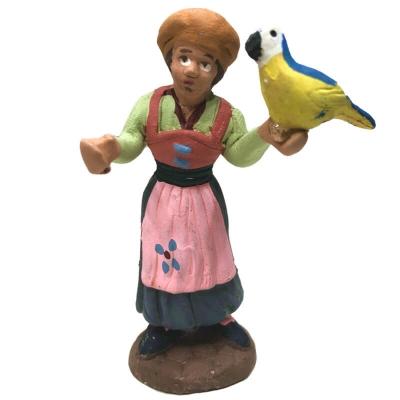 Donna con pappagallo in terracotta 7 cm