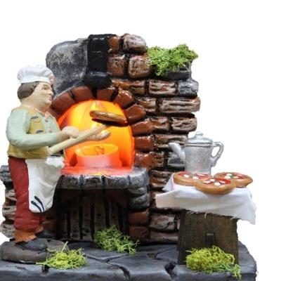 Panettiere al forno che lavora il pane da 10 cm